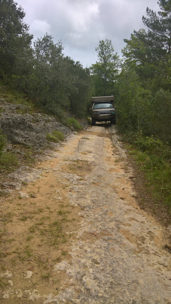 Range rover camper green laning on tracks in the France