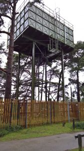 "WW"" steel water tower in Hampshire campsite UK"