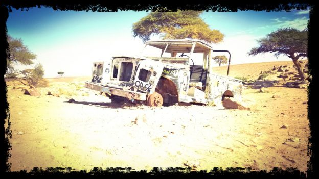 Land rover series 3 carcass in the desert