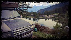 overland camper at unusual dam