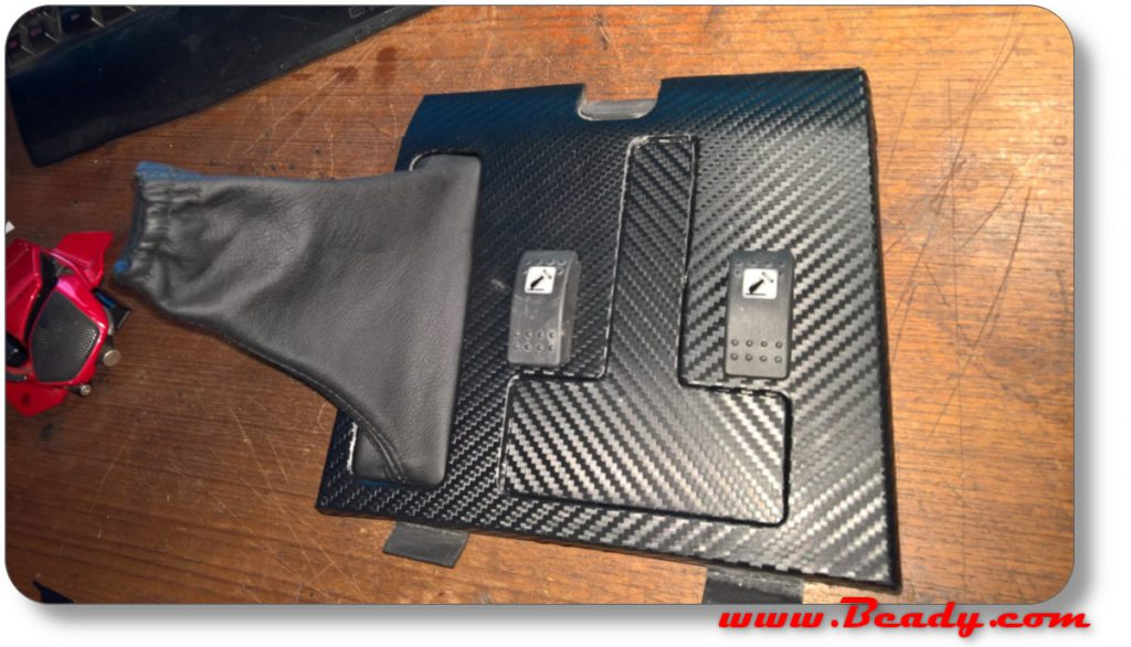 custom switch panel in carbon fibre for range rover