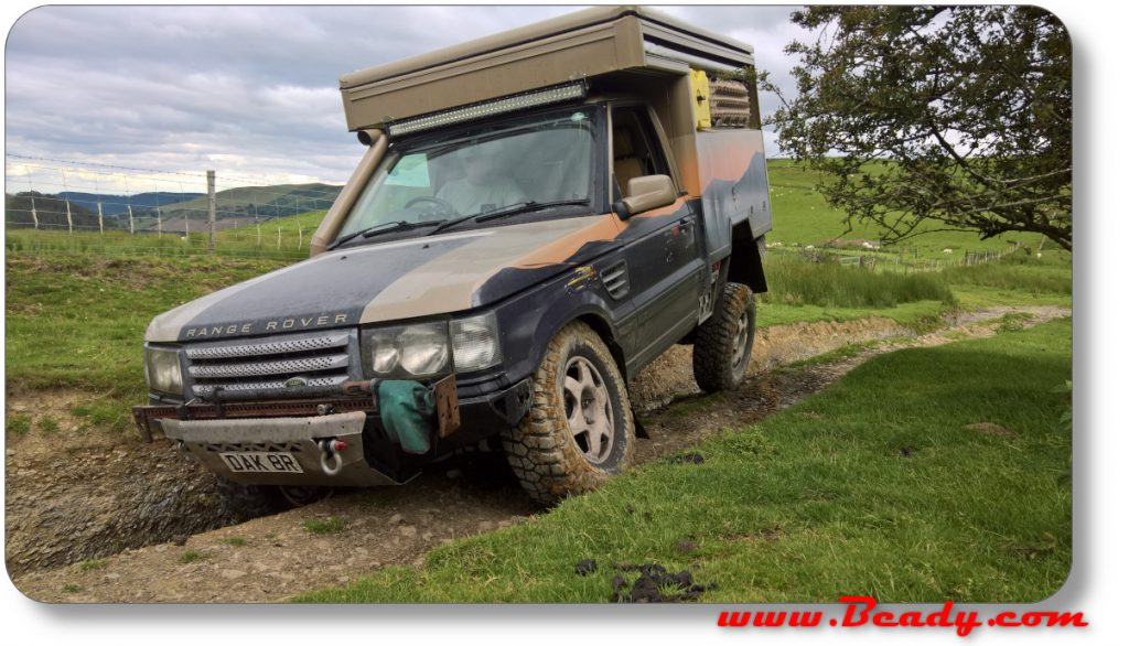 Range rover under extreme cross axle in Wales