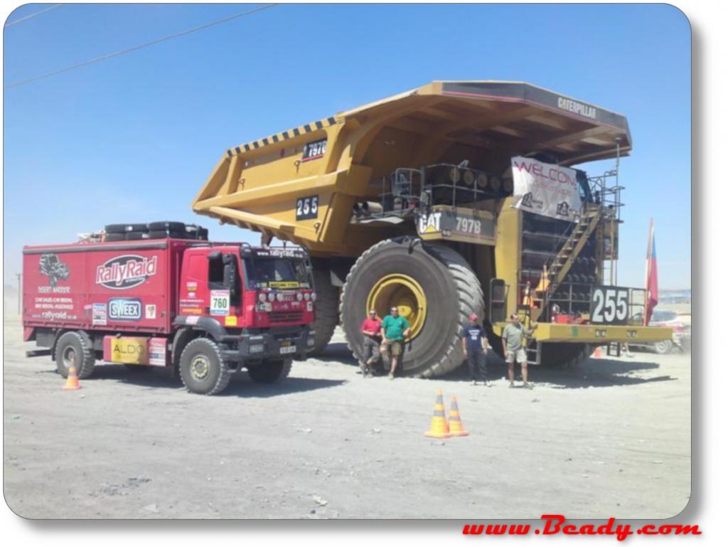 dakar support truck iveco next to massive dump truck