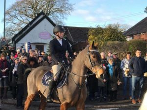 Chloe and Harold in the boxing day hunt in Woore wearing here Equestrian World of Maynooth saddle cloth.